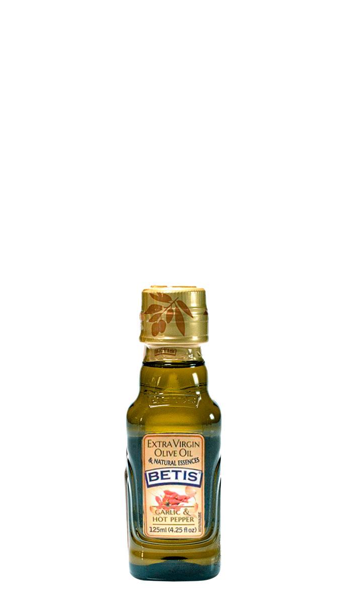Caja de 24 botellas vidrio de 125 ml de aceite de oliva virgen extra BETIS y esencia natural de ajo y guindilla